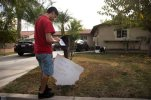 A brother of Enrique Marquez collects his mail Wednesday, Dec. 9, 2015, in Riverside, Calif. Authorities have said Enrique Marquez, an old friend of San Bernardino attacker Syed Farook, purchased two assault rifles used in last week's fatal shooting that killed 14 people. (AP Photo/Jae C. Hong)