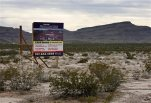 A sign advertises Mountain View Industrial Park near Apex Industrial Park on Wednesday, Dec. 9, 2015, in North Las Vegas, Nev. Chinese-backed electric carmaker Faraday Future plans to build a manufacturing plant near the site, according to a letter the company sent Nevada officials Wednesday. (AP Photo/John Locher)