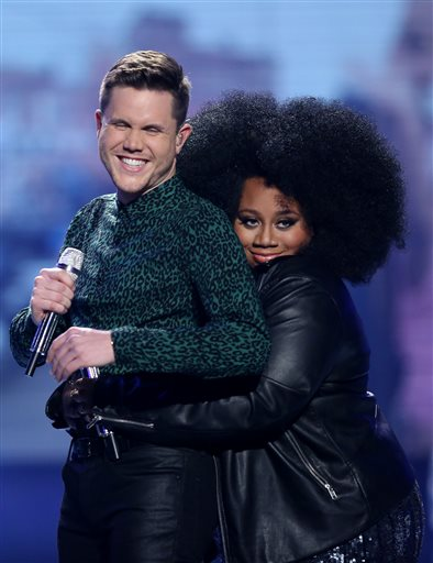 "Trent Harmon, left, and La'Porsha Renae appear at the ""American Idol"" farewell season finale at the Dolby Theatre on Thursday, April 7, 2016, in Los Angeles. (Photo by Matt Sayles/Invision/AP)"