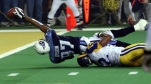 In this Jan. 30, 2000 file photo, Tennessee Titans wide receiver Kevin Dyson (87) tries but fails to get the ball into the end zone as he is tackled by St. Louis Rams' Mike Jones on the final play of Super Bowl XXXIV. (AP file)