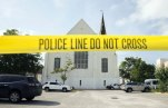 In this June 19, 2015 file photo, police tape surrounds the parking lot behind the AME Emanuel Church as FBI forensic experts work the crime scene, in Charleston, S.C. Prosecutors who wanted to show that Dylann Roof was a cruel, angry racist simply used his own words at his death penalty trial on charges he killed nine black people in June 2015 at a Charleston church. Roof's two-hour videotaped confession less than a day after the shooting and a handwritten journal found in his car when he was arrested were introduced into evidence Friday, Dec. 9, 2016. (AP Photo/Stephen B. Morton, File)