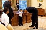 In this 2009 file photo, Jacob Philadelphia, 5, reaches out to touch President Barack Obama's hair during a meeting in the Oval Office. (Pete Souza/The White House/CC BY 3.0)