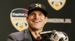 Michigan head coach Jim Harbaugh smiles during a news conference in Fort Lauderdale, Florida, on  Thursday, Dec. 29, 2016. (AP file)